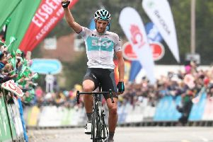 Team Sky's Ian Stannard celebrates winning the stage.