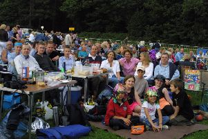2002: Family and friends gather around tables with their buffet, drinks and goodies ready for a good night at the 60s concert at Clumber Park.