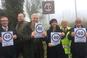 MP Caroline Flint (third right) joins, from left, Coun Martin Greenhalgh, farmer Richard Spencer, businessman Arnold Pawson, Coun John Parkes, chairman of Braithwell Parish Council, and Coun Nigel Cannings to say thankyou for the 40mph speed limit.