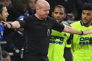CARDIFF, WALES - JANUARY 12:  Referee Lee Mason changes his mind over awarding Huddersfield a penalty as the Huddersfield players Jason Puncheon and Elias Kachunga react to the news during the Premier League match between Cardiff City and Huddersfield Town at Cardiff City Stadium on January 12, 2019 in Cardiff, United Kingdom.  (Photo by Stu Forster/Getty Images)
