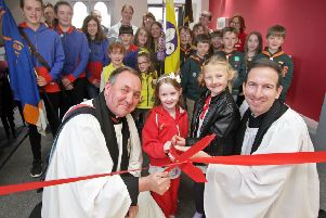 Archdeacon David Picken, Reverend Peter Stanley, and community groups celebrate the reopening of Shireoaks village hall after extensive refurbisments.