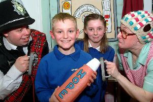 2009: Kinetic Theatre perform The Hospital Farce at St Augustines School in Worksop. Actors Adrian Wilson and Bridget Lambert are pictured with pupils Thomas Sharpe and Paige Turley.