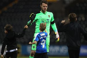 Adam Collin of Notts County celebrates with young supporters during The Emirates FA Cup Fourth Round match between Notts County and Swansea City at Meadow Lane on January 27, 2018 in Nottingham, England.  (Photo by Clive Mason/Getty Images)