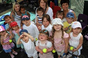 2010: This fabulous nostalgic group shot features children and staff from Lilliput Day Nusery. The nursery held a tennis day on The Canch tennis courts. Are you on this picture?