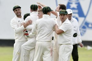 Collingham & Linton players celebrate a wicket at Adel - and staying up. PIC: Steve Riding