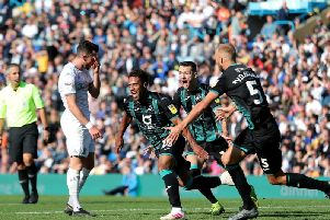 SICKENER: Leeds United winger Jack Harrison shows his frustration as Swansea City's Wayne Routledge bags a last-gasp winner in a 1-0 victory for Swansea City at Elland Road last month, a game which the Whites dominated.