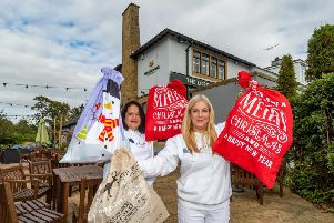The Leeds Homeless Street Angels Becky and Shelley Joyce launch their Christmas Sack Appeal at the Lord Darcy pub