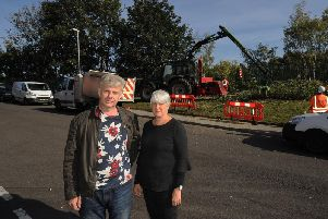 Caleb Price and Fiona Blair pictured on Armley Park Road as contractors working for Network Rail remove trees.'Picture: Simon Hulme