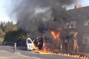 A 13-year-old boy arrested and a man charged after a van was set on fire in Halton Moor
