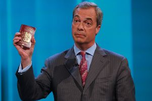 SIDESHOW: Ukip leader Nigel Farage holding his passport as he takes part in ITV's EU referendum debate.