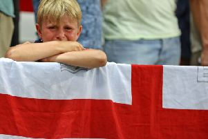 A young England fan sobs after seeing England beaten by Iceland at Euro 2016. Credit: Owen Humphreys/PA Wire.
