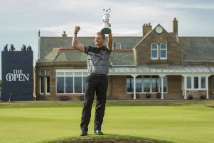 HISTORY BOY: Henrik Stenson celebrates winning the Open with a record score. But how many got to see it?