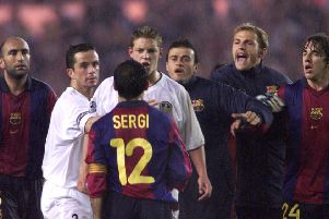 MEMORIES: Leeds United's Alan Smith confronts Barcelona's Sergi during their Champions League draw at Elland Road in  2000. PIC: PA