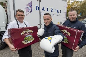 Josh Warrington with David Pilling from St George's Crypt and Dalziel's Jim McLean.