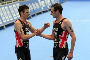 OUT IN FRONT: Jonny Brownlee, left, and brother Alistair embrace at the finish line in Leeds last weekend.