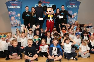 Lucky children with Ashley Banjo get a visit from Mickey Mouse during a Disney On Ice Fit To Dance workshop