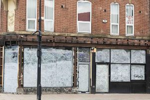 A boarded up shop.