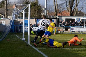 Dayle Southwell, of Guiseley, scores against Maidenhead United, at Nethermoor. PIC: James Hardisty