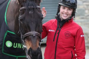 Kate Harrington with Cheltenham Gold Cup winner Sizing John during yesterday's open day at trainer Jessica Harrington's Commonstown Stables in Moone, Ireland (Picture: Niall Carson/PA Wire).