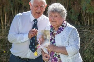 DIAMOND COUPLE: Mr and Mrs Swift with their card from the Queen.