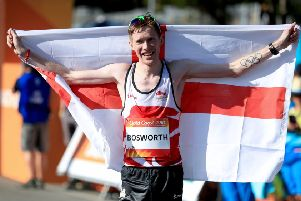 Leeds' Tom Bosworth celebrates taking silver in the Men's 20km Race Walk Final during day four of the 2018 Commonwealth Games.