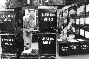 Leeds, 18th May 1983''Equipping 334 polling stations in leeds with ballot boxes and election notices has been a long job for Leeds Electoral registration office clerk messsengers Wilf Lister (left) and Peter Sharpe.''The pair have spent most of the time leading up to polling day in the Belgrave House storage room, getting the boxes ready to serve the city's eight constituencies.''About 50 of the boxes have needed repairing after suffering damage at the May local councilelections, but this is put down to wear and tear.''The most common problem with the boxes has been damaged locks, but som eof them have seen many years of election service, said Mr. Tom McCarthy, deputy elections officer.''Each box is equipped with notices, stamping equipment, and pencils.''More than 600,000 ballot papers were handed out to presiding officers when they were sworn in on Tuesday to give their declaration of secrecy, said Mr. McCarthy.