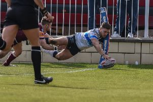 Shaun Robinson dives over for one of his three tries for Featherstone Rovers against Batley Bulldogs. PIC: Dec Hayes