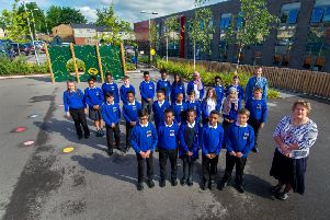 Children from  Little London Community Primary School, Leeds, with teachers. PIC: James Hardisty/YPN