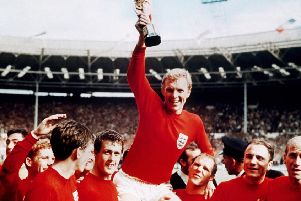 World Cup winners: England captain Bobby Moore, carried shoulder high by Geoff Hurst, left, and Ray Wilson. Picture: AP