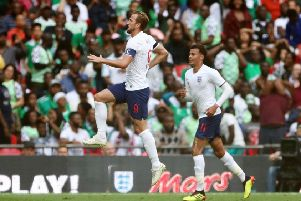 Get in: England's Harry Kane celebrates scoring his side's second goal against Nigeria.