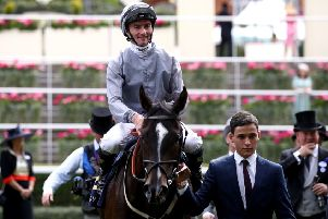 Danny Tudhope returns to the winner's enclosure after Soldier's Call won the Windsor Castle Stakes at Royal Ascot.