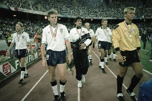 England and Italy players do a lap of honour after the FIFA World Cup 3rd Place play-off at Stadio San Nicola on July 07, 1990 in Bari. In front are Chris Waddle (left) and Chris Woods (right). (Picture: Professional Sport/Popperfoto/Getty Images)