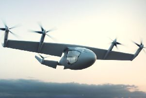 Photo issued by Rolls-Royce PLC of a flying taxi concept which has been unveiled by engine maker. The hybrid vehicle could transport five passengers at speeds of 250mph for up to 500 miles without being recharged. PA