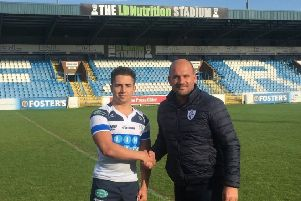 Dakota Whylie is welcomed by general manager Davide Longo after signing for Featherstone Rovers on a one-year deal for 2019.