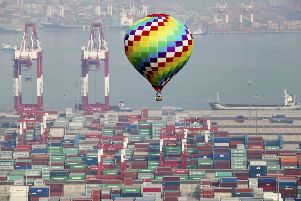 A hot-air balloon flies over a container port in Qingdao in east China's Shandong province