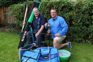 Former YEP columnist Dennis Lemmon with just a sample of the fishing tackle he donated to the juniors under the guidance of Yarnbury Angling Club coach Adie Addy.