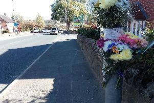 Floral tributes left at the scene of the accident, in Wide Lane, Morley