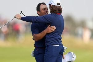 Open champion Francesco Molinari, left, and European No 1 Tommy Fleetwood embrace after completing victories in both their fourball and foursomes matches as Europe took a 5-3 first-day lead over the US in the Ryder Cup (Picture: David Davies/PA Wire).