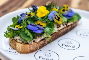 Crab tartine, soft herb salad and bisque butter. PIC: James Hardisty