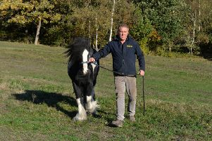 Garry Chalders with Henry, one of the horses he keeps on Sugar Hill in Meanwood.  Picture: Bruce Rollinson