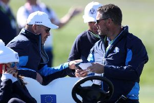 Team Europe captain Thomas Bjorn and vice-captain Lee Westwood look at notes during the Ryder Cup at Le Golf National, Paris. Picture: David Davies/PA