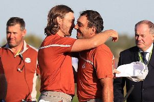 'MOLIWOOD': Francesco Molinari and Tommy Fleetwood, left, celebrate victory on day two of the Ryder Cup in Paris. Picture: Gareth Fuller/PA