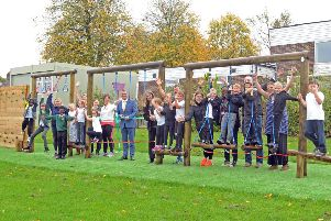 5 October  2018......    Stuart Andrew MP with PTA members and children with the new trim trail play equipment at Broadgate Primary School in Horsforth.  Picture Tony Johnson.