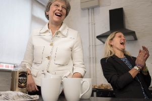 Tea for two? Theresa May launches the Government's loneliness strategy with Kim Leadbeater, the sister of murdered MP Jo Cox.
