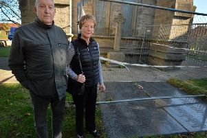 Peter Blower, pictured with his wife Hazel, at the war memorial at the St Mary the Virgin church grounds in Hunslet.