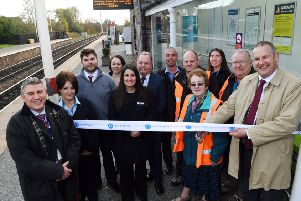OPEN: Pete Myers, of Northern, cuts the ribbon to the newly-improved Garforth station.