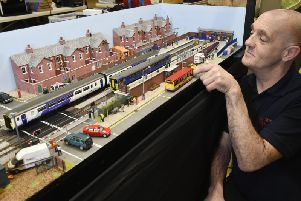 Shaun Taylor, of Howden, with his layout fictional West Street Station OO gauge with a modern image.