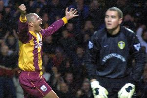 Stan Collymore celebrates his opening goal for Bradford City while Leeds goalkeeper Paul Robinson looks dejected during the Premiership clash Sunday October 29, 2000 at Valley Parade. PIC:: John Giles/PA Wire