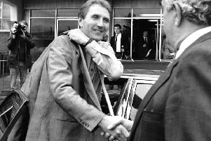 Howard Wilkinson arriving at Elland Road to be greeted by Leslie Silver to start his new job as manager in October 1988. PIC: Yorkshire Post Newspapers