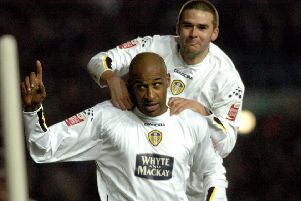 Brian Deane celebrates his fourth goal against QPR in 2004 with David Healy.